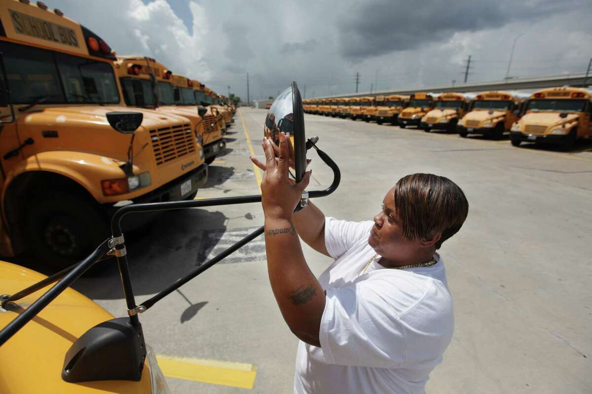 """Shavaughn Raglon preps her Alief ISD bus Friday. """"I love working with kids,"""" she says, but her 12 years as a driver are unusual."""