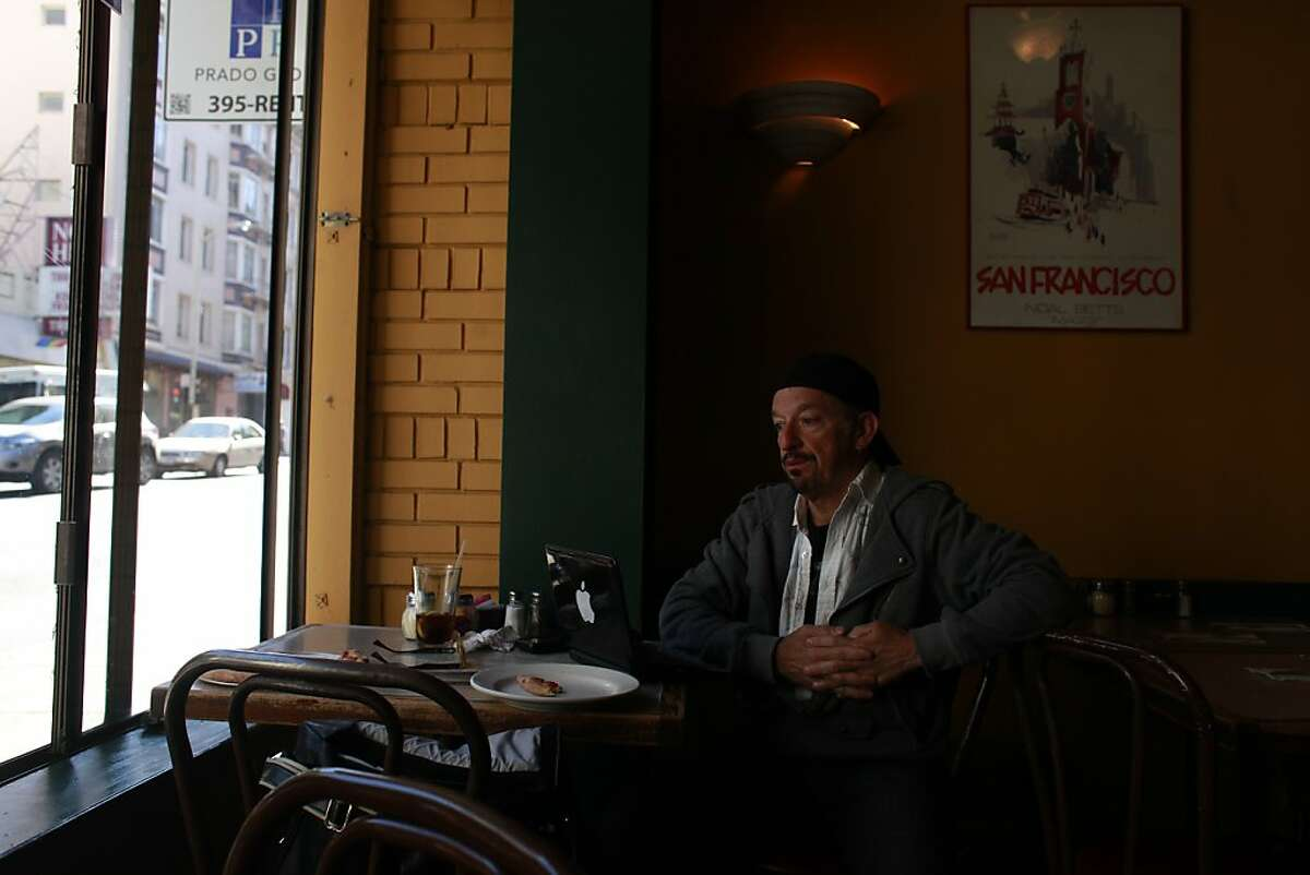 Ken Newman waits at Uncle Vito's pizza restaurant on Bush Street for the chance to meet Marian B. Brown, who dines there daily.
