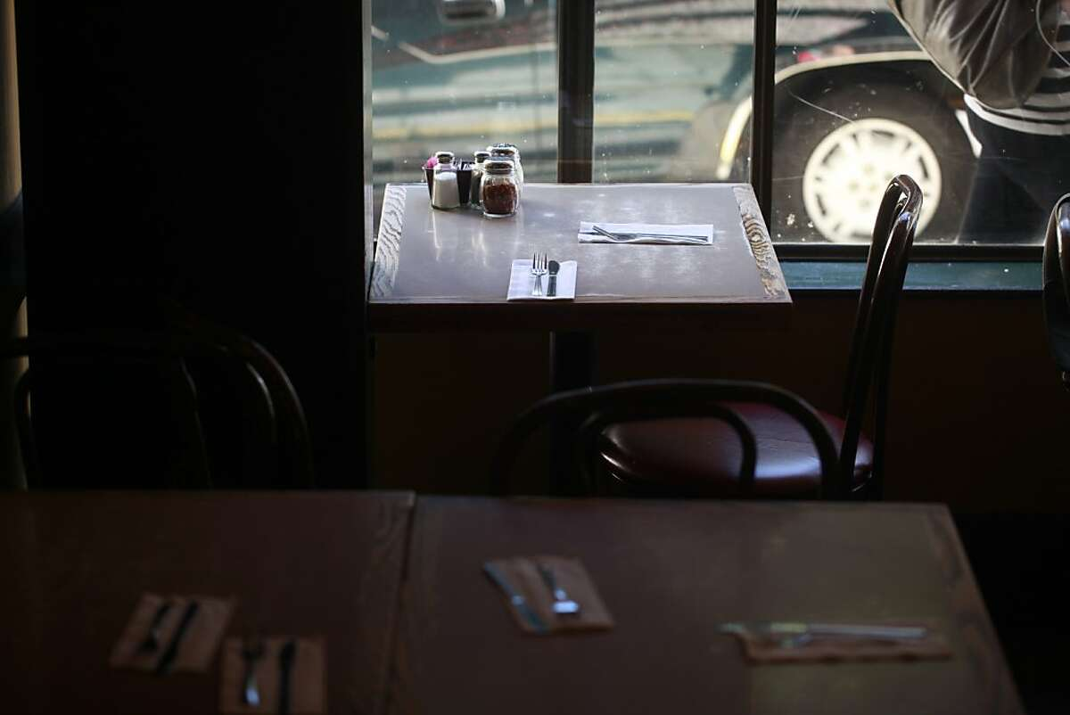 The table usually reserved for the Brown twins sits empty at Uncle Vito's on Friday Aug, 17, 2012 in San Francisco, Calif.