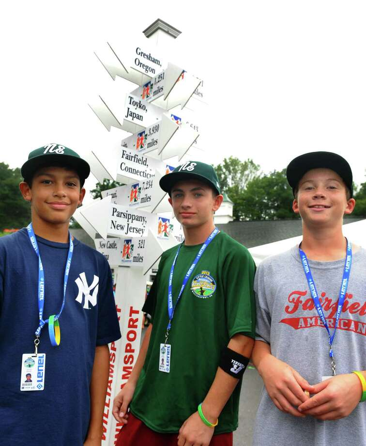 New England's Michael Ghiorzi, left, Biagio Paoletta, center, and Daniel Kiernan stand in front of the pole showing directions and distance of all the teams at the Little Leauge World Series in South Williamsport, Penn. on Friday August 17, 2012. Photo: Christian Abraham / Connecticut Post