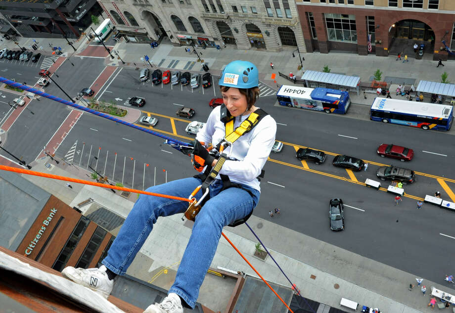Helena DeCaprio of Schenectady rappels down the 18 story side of Hotel Albany for the Over The Edge event to benefit the Special Olympics on Friday, Aug. 17, 2012 in Guilderland, N.Y.  (Lori Van Buren / Times Union) Photo: Lori Van Buren