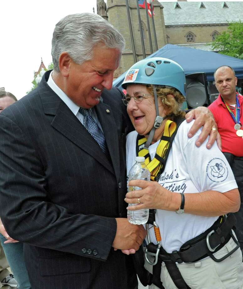 Albany Mayor Jerry Jennings congratulates  70-year-old Gail Wrieden of Latham after she rappelled down the 18 story side of Hotel Albany for the Over The Edge event to benefit the Special Olympics on Friday, Aug. 17, 2012 in Guilderland, N.Y.  (Lori Van Buren / Times Union) Photo: Lori Van Buren