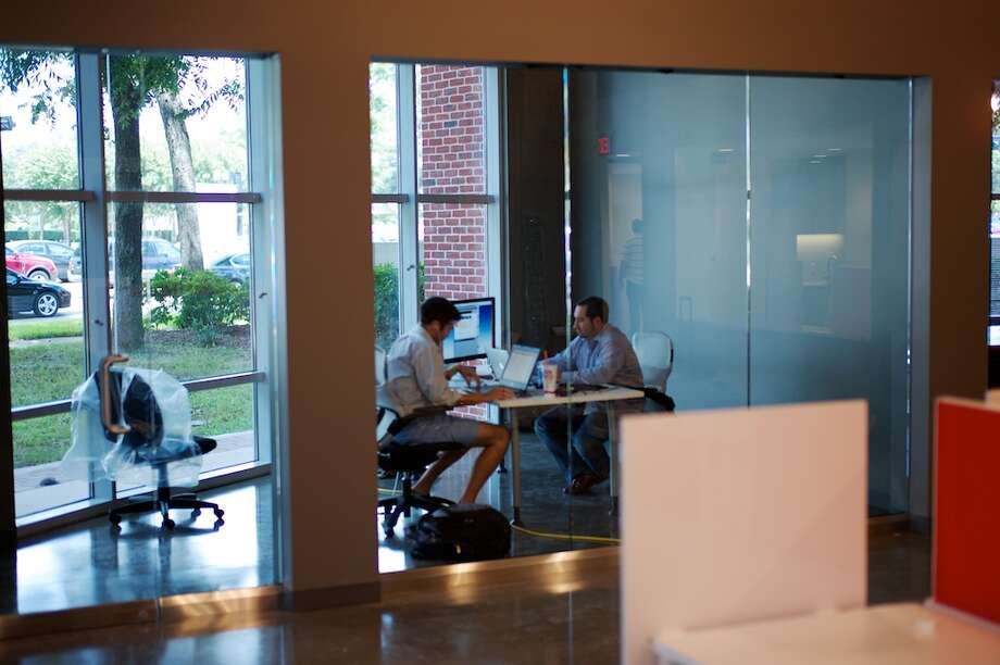 Todd Dunphy, co-founder and president of Validas, left, and Tom Pepe, co-founder and CEO, try out the technology company's glass-walled offices in Sugar Land Town Square.