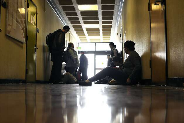 Students sit in the hall outside of classes they hope to crash at City College of San Francisco on Friday August 17th, 2012 Photo: Michael Short, Special To The Chronicle