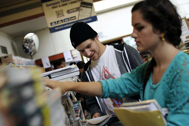 1st year students Luke Belz(L) and Jill Colin shop for text books in the campus bookstore at City College of San Francisco on Friday August 17th, 2012 Photo: Michael Short, Special To The Chronicle