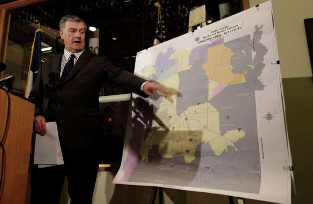 Dallas Mayor Mike Rawlings points to a map showing Dallas County and the aerial spraying against mosquitos during a news conference in downtown Dallas, Friday, Aug. 17, 2012. Dallas County has been the epicenter of the nation's worst outbreak of West Nile virus, which has killed 10 people and sickened at least 200 others.  (AP Photo/LM Otero) Photo: LM Otero, Associated Press / AP