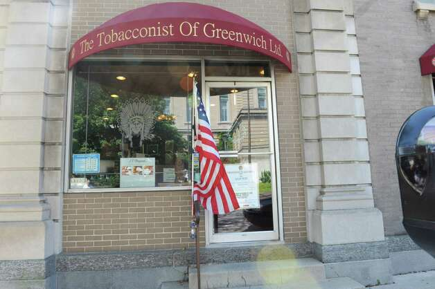 The Tobacconist of Greenwich at 8 Havemeyer Place, Thursday Aug. 16, 2012.  T. Michael Cafagno, owner of the Tobacconist of Greenwich LTD won a national award called the Golden Band Davidoff Best Performance Award. Photo: Helen Neafsey / Greenwich Time
