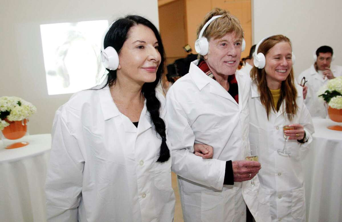 Maria Abramovic with Robert Redford and his daughter-in-law, Kyle, at Abramovic's silent party during the Sundance Film Festival in Park City, Utah, on Jan. 21, 2012. HBO held the high-concept party to celebrate