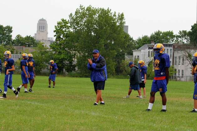 Bishop Maginn football coach Joe Grasso instructs his players on a passing drill during practice at the school, Friday Aug. 17, 2012 in Albany, N.Y. (Dan Little/Special to the Times Union) Photo: Dan Little / Dan Little