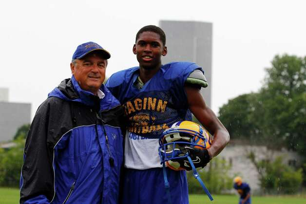 Bishop Maginn football coach Joe Grasso, left, and wide receiver Derek Thomas, right, stand for a picture during a break in practice, Friday Aug. 17, 2012 in Albany, N.Y. (Dan Little/Special to the Times Union) Photo: Dan Little / Dan Little