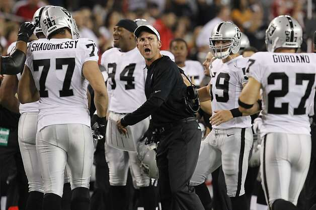 Oakland Raiders head coach Dennis Allen makes a call against the Arizona Cardinals during the first half of a preseason NFL football game, Friday, Aug. 17, 2012, in Glendale, Ariz. (AP Photo/Ross D. Franklin) Photo: Ross D. Franklin, Associated Press