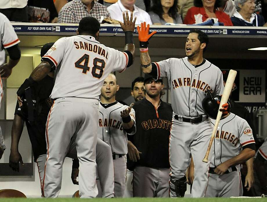 Pablo Sandoval and company had several chances to celebrate in the third inning. Photo: Denis Poroy, Getty Images
