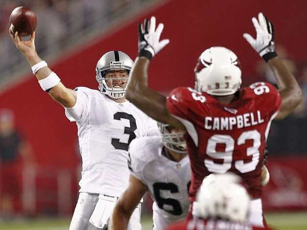 Raiders quarterback Carson Palmer made some nice passes but also threw a bad interception. Photo: Matt York, Associated Press