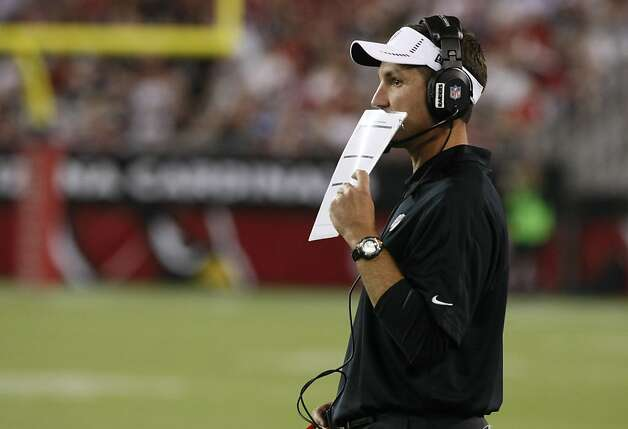 Oakland Raiders head coach Dennis Allen calls a play during the first half of a preseason NFL football game against the Arizona Cardinals, Friday, Aug. 17, 2012, in Glendale, Ariz. (AP Photo/Rick Scuteri) Photo: Rick Scuteri, Associated Press