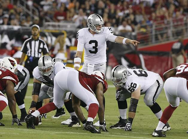 Oakland Raiders quarterback Carson Palmer (3) calls a play against the Arizona Cardinals during the first half of a preseason NFL football game, Friday, Aug. 17, 2012, in Glendale, Ariz. (AP Photo/Rick Scuteri) Photo: Rick Scuteri, Associated Press