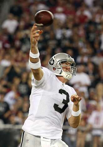 GLENDALE, AZ - AUGUST 17:  Quarterback Carson Palmer #3 of the Oakland Raiders throws a pass during the NFL preseason game against the Arizona Cardinals at the University of Phoenix Stadium on August 17, 2012 in Glendale, Arizona.  (Photo by Christian Petersen/Getty Images) Photo: Christian Petersen, Getty Images
