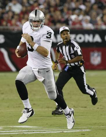 Oakland Raiders quarterback Carson Palmer (3) scrambles against the Arizona Cardinals during the first half of a preseason NFL football game, Friday, Aug. 17, 2012, in Glendale, Ariz. (AP Photo/Rick Scuteri) Photo: Rick Scuteri, Associated Press