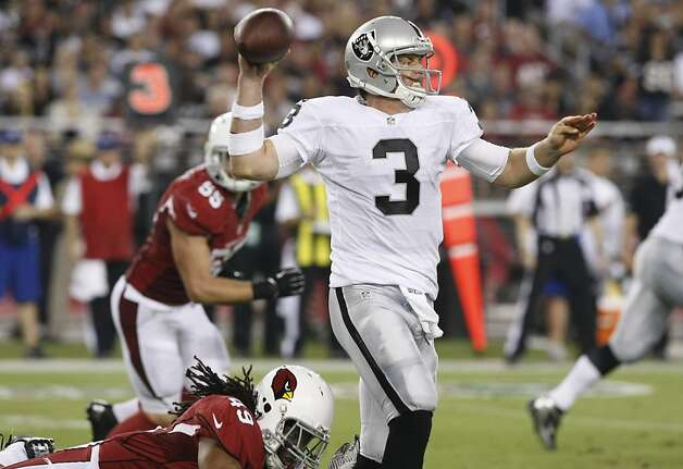 Oakland Raiders quarterback Carson Palmer (3) escapes the reach of Arizona Cardinals defensive back Rashad Johnson during the first half of a preseason NFL football game, Friday, Aug. 17, 2012, in Glendale, Ariz. (AP Photo/Rick Scuteri) Photo: Rick Scuteri, Associated Press