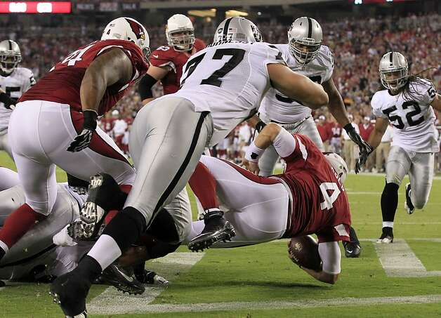 Arizona Cardinals quarterback Kevin Kolb (4) gets tackled in the end zone for a safety in the first half of a preseason NFL football game against the Oakland Raiders, Friday, Aug. 17, 2012, in Glendale, Ariz. (AP Photo/Ross D. Franklin) Photo: Ross D. Franklin, Associated Press