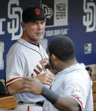 SAN DIEGO, CA - AUGUST 17: Bruce Bochy #15 manager of the San Francisco Giants, left, talks with Pablo Sandoval #48 before a baseball game against the San Diego Padres at Petco Park on August 17, 2012 in San Diego, California. (Photo by Denis Poroy/Getty Images) Photo: Denis Poroy, Getty Images