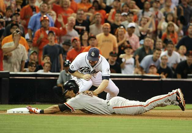SAN DIEGO, CA - AUGUST 17: Angel Pagan #16 of the San Francisco Giants slides into third base with a triple ahead of the tag of Chase Headley #7 of the San Diego Padres during the third inning of a baseball game at Petco Park on August 17, 2012 in San Diego, California. (Photo by Denis Poroy/Getty Images) Photo: Denis Poroy, Getty Images