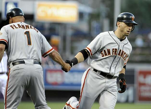 SAN DIEGO, CA - AUGUST 17: Marco Scutaro #19 of the San Francisco Giants, right, is congratulated by Tim Flannery #1 after hitting a solo home run during the first inning of a baseball game against the San Diego Padres at Petco Park on August 17, 2012 in San Diego, California. (Photo by Denis Poroy/Getty Images) Photo: Denis Poroy, Getty Images