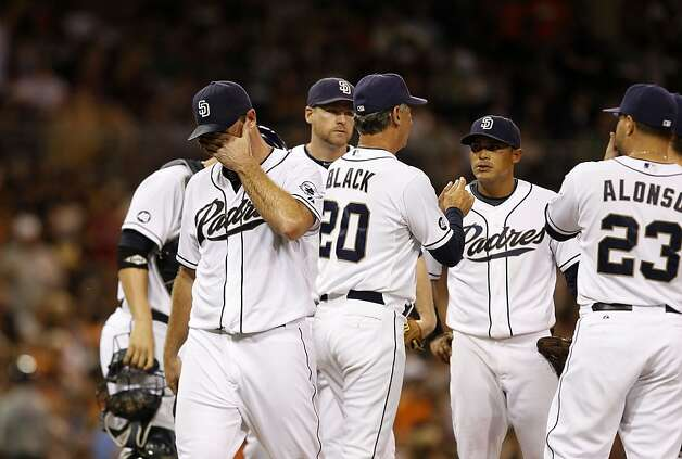 San Diego Padres starting pitcher Ross Ohlendorf, left,  walks off the mound after giving the ball to manager Bud Black during the third inning of a baseball game against the San Francisco Giants Friday, Aug. 17, 2012 in San Diego.   Ohlendorf lasted two and a third innings and allowed nine runs, eight earned, and eight during the third inning. (AP Photo/Lenny Ignelzi) Photo: Lenny Ignelzi, Associated Press