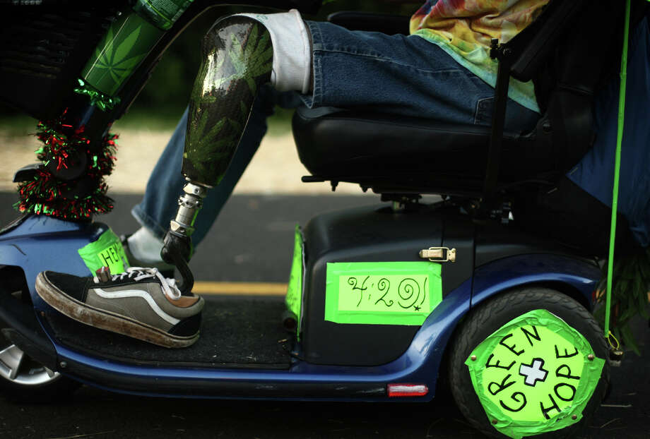 Medical marijuana patient Terry Day wears a carbon fiber leg customized with pot leafs as he rides around during Seattle's Hempfest pro marijuana gathering at Myrtle Edwards Park on the Seattle waterfront on Friday, August 17, 2012. Hundreds of thousands of people are expected to attend the festival that lasts through the weekend. Photo: JOSHUA TRUJILLO / SEATTLEPI.COM