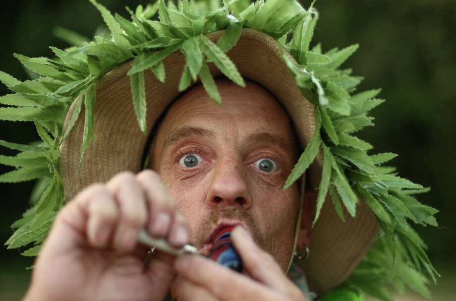 Medical marijuana patient Terry Day smokes marijuana during Seattle's Hempfest pro marijuana gathering at Myrtle Edwards Park on the Seattle waterfront on Friday, August 17, 2012. Hundreds of thousands of people are expected to attend the festival that lasts through the weekend. Photo: JOSHUA TRUJILLO / SEATTLEPI.COM