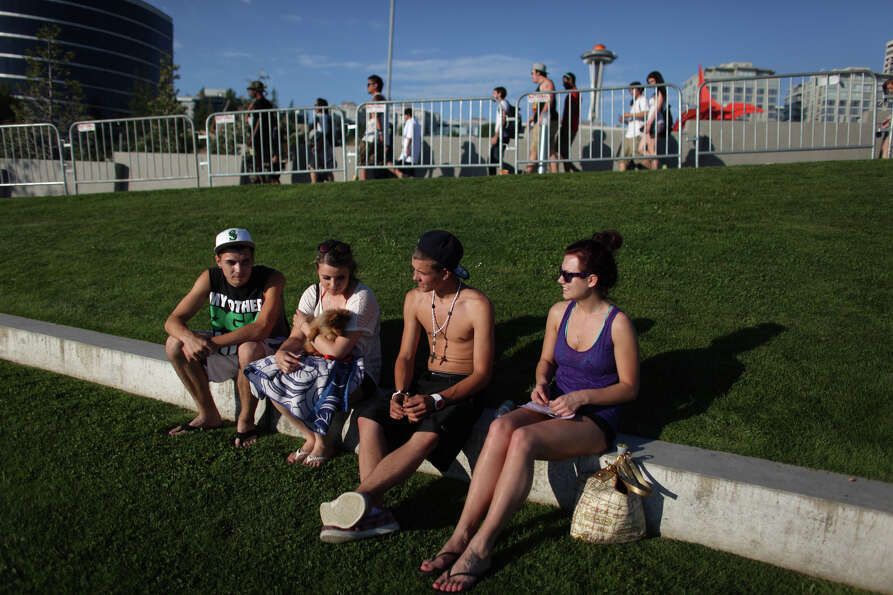 Participants relax at the entry area during Seattle's Hempfest pro marijuana gathering at Myrtle Edw