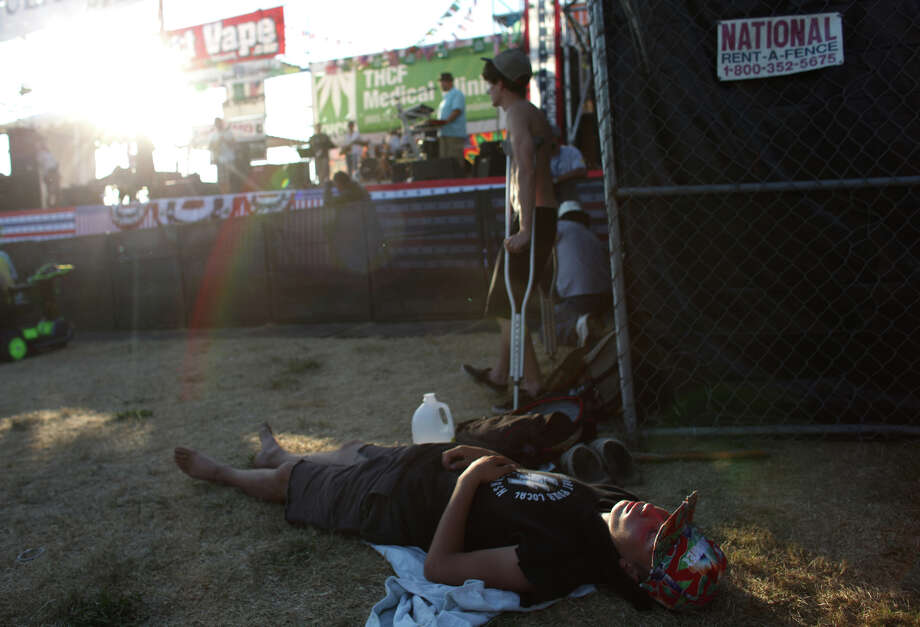 A participant sleeps in front of the main stage during Seattle's Hempfest pro marijuana gathering at Myrtle Edwards Park on the Seattle waterfront on Friday, August 17, 2012. Hundreds of thousands of people are expected to attend the festival that lasts through the weekend. Photo: JOSHUA TRUJILLO / SEATTLEPI.COM