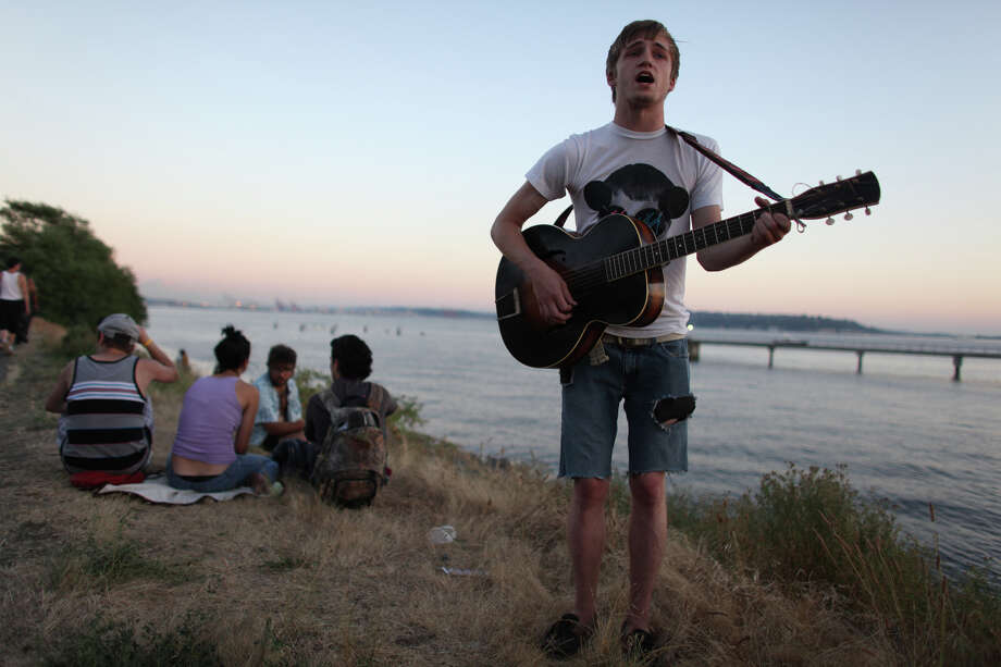 Aaron Berryhill of Tacoma plays his guitar during Seattle's Hempfest pro marijuana gathering at Myrtle Edwards Park on the Seattle waterfront on Friday, August 17, 2012. Hundreds of thousands of people are expected to attend the festival that lasts through the weekend. Photo: JOSHUA TRUJILLO / SEATTLEPI.COM