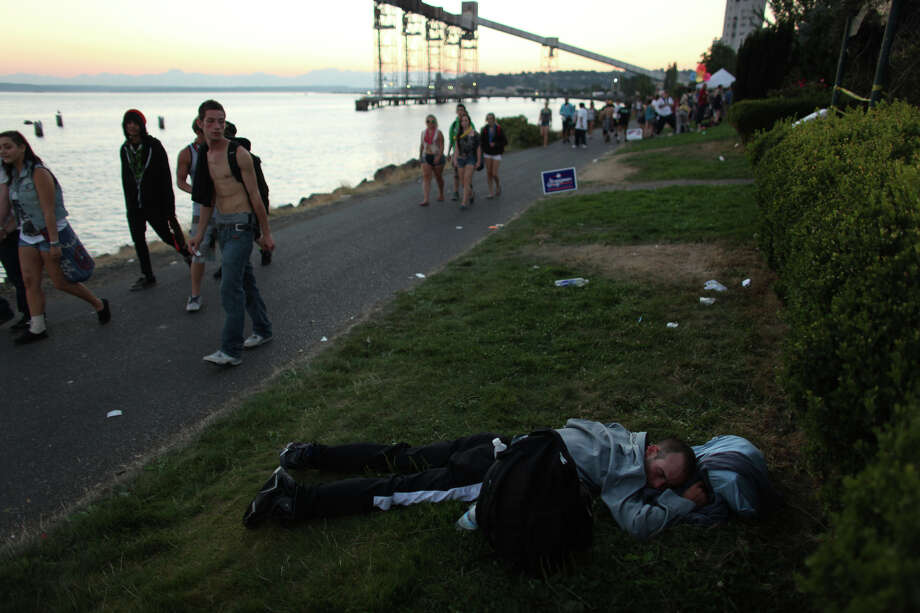 A participant is passed out along a path during Seattle's Hempfest pro marijuana gathering at Myrtle Edwards Park on the Seattle waterfront on Friday, August 17, 2012. Hundreds of thousands of people are expected to attend the festival that lasts through the weekend. Photo: JOSHUA TRUJILLO / SEATTLEPI.COM