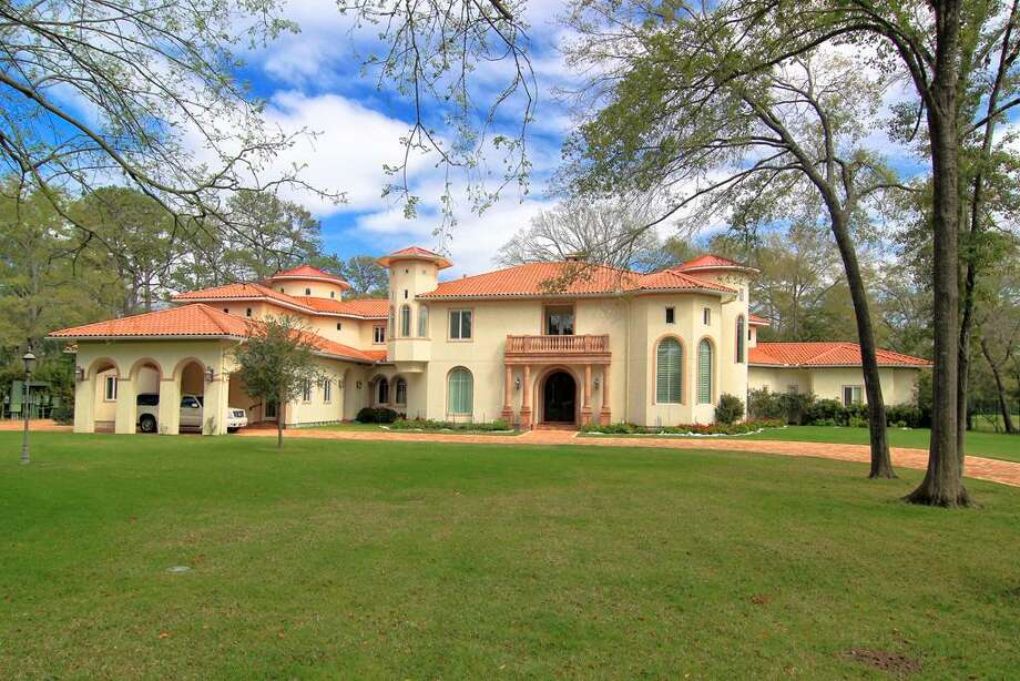 20 E. Rivercrest :  Exclusive Rivercrest Mediterranean style home built in 2005 on beautiful estate of about four acres. Soaring ceilings, spacious rooms and custom details, including caretaker's cottage, two kitchens and an elevator. Open House: 10/21/2012, 2 to 4 p.m. Photo: Chron.com/homes