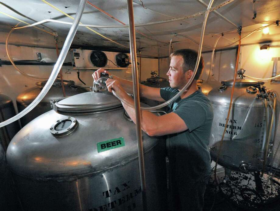Senior brewer Chad Wysocki checks one of the serving tanks for the bar at Browns Brewery in Troy Wednesday July 25, 2012.   (John Carl D'Annibale / Times Union) Photo: John Carl D'Annibale / 00018590A