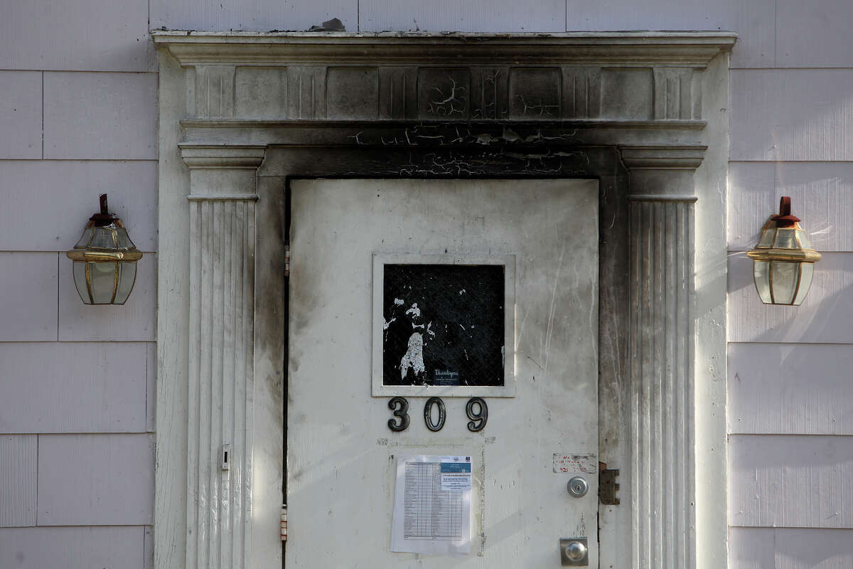 The Amistad Residential Facility, a house where four men died in a fire Wednesday night, is quiet on Saturday, August 18, 2012 in San Antonio.
