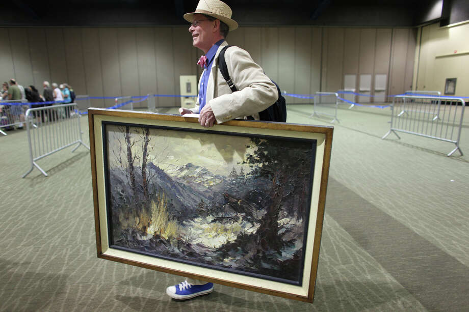 Michael carries a painting to be appraised. Photo: JOSHUA TRUJILLO / SEATTLEPI.COM