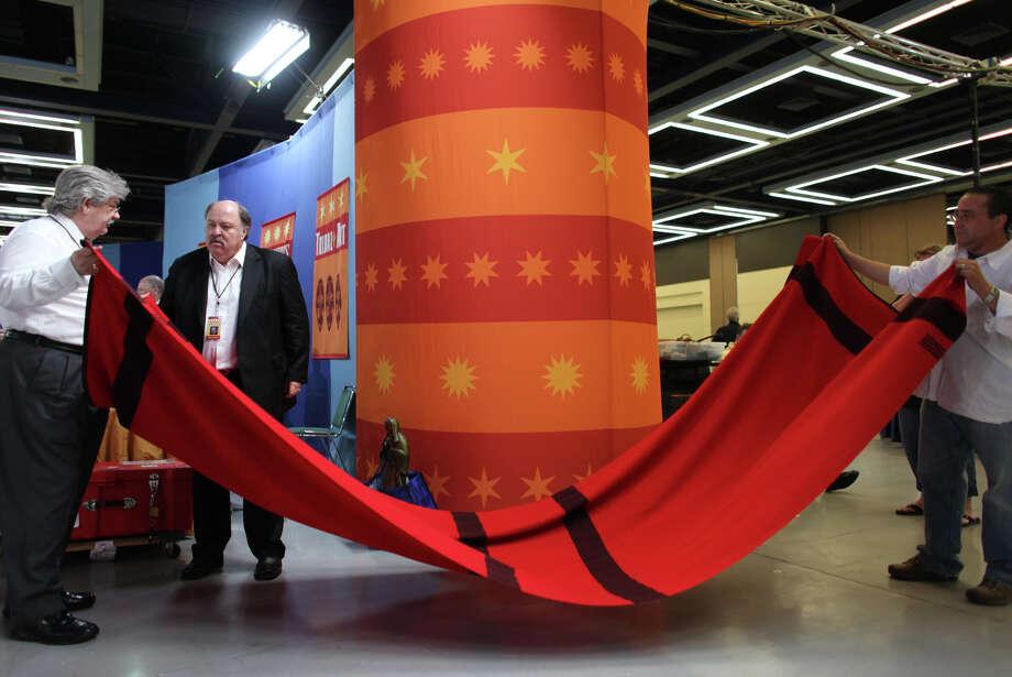 Mark, right, has a Native American Pendleton blanket appraised. Photo: JOSHUA TRUJILLO / SEATTLEPI.COM