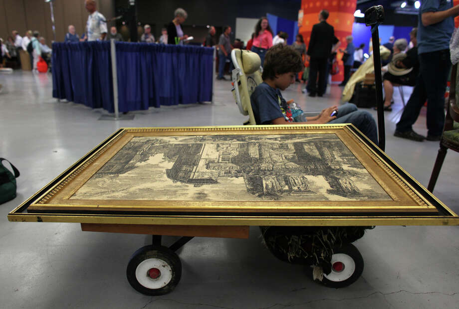 Alexander sits with a 16th or 17th century etching while waiting in line. Photo: JOSHUA TRUJILLO / SEATTLEPI.COM