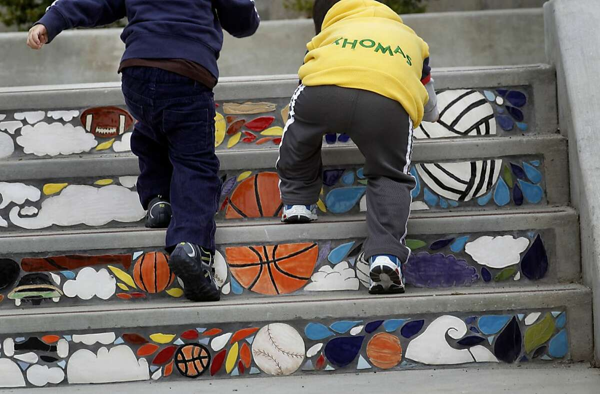 Marcus Lee, 2 (left) and Eric Wong, 2 climb the playground stairs created by Denman Middle School, during the grand reopening of Balboa Park on Saturday August 18, 2012, in San Francisco, Calif., which is in the middle of the city's greatest concentration of kids.