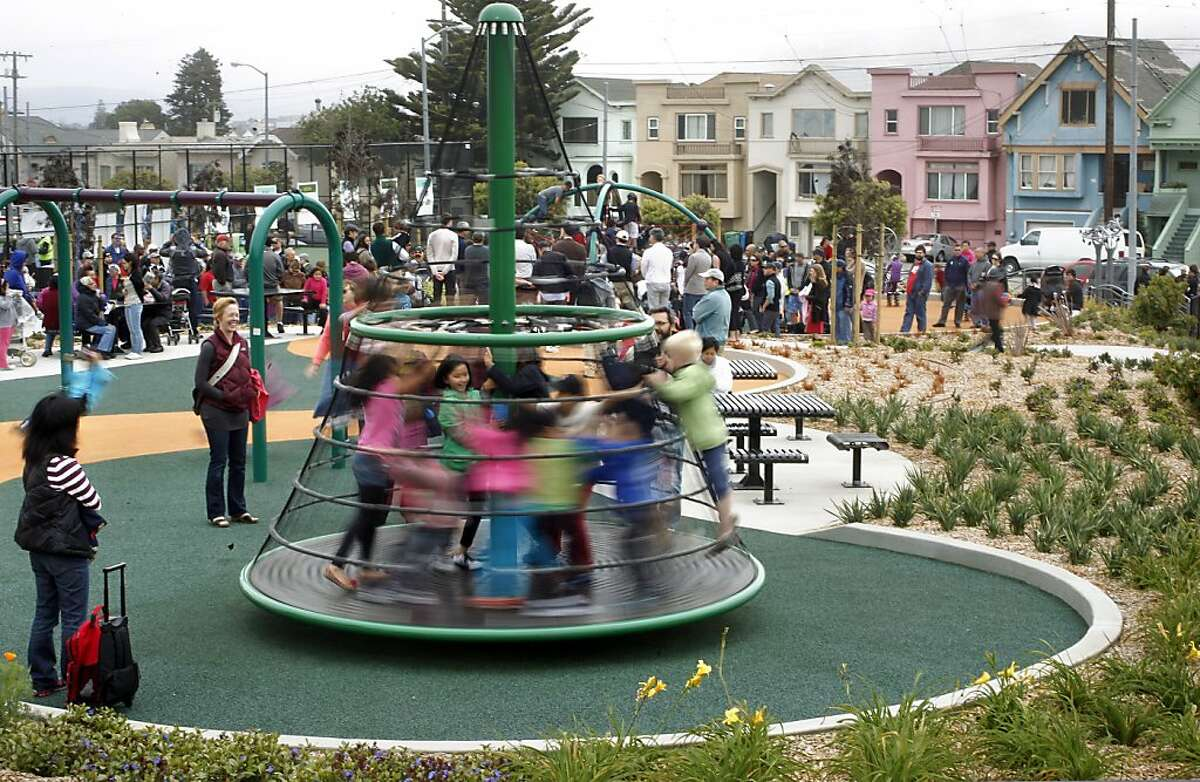 Children crowd the new playground equipment, as a grand reopening of Balboa Park took place on Saturday August 18, 2012, in San Francisco, Calif., which is in the middle of the city's greatest concentration of kids.