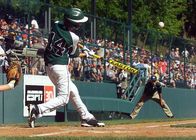 New England's #14 Chris Meyers gets a hit, during 2012 Little League World Series game action against Midwest in South Williamsport, Penn. on Saturday August 18, 2012. Photo: Christian Abraham / Connecticut Post