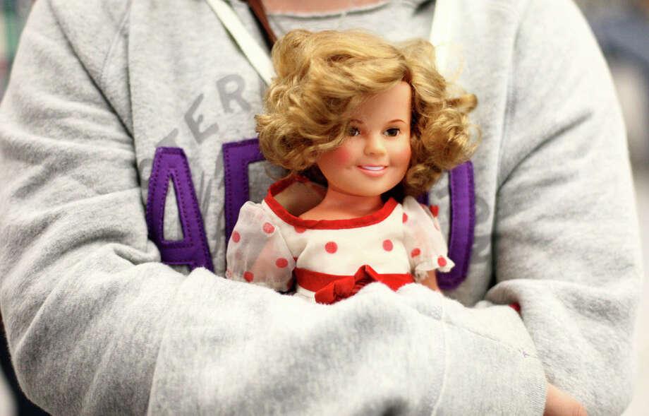 Lily, 12, holds her doll while waiting for an appraisal. Photo: JOSHUA TRUJILLO / SEATTLEPI.COM