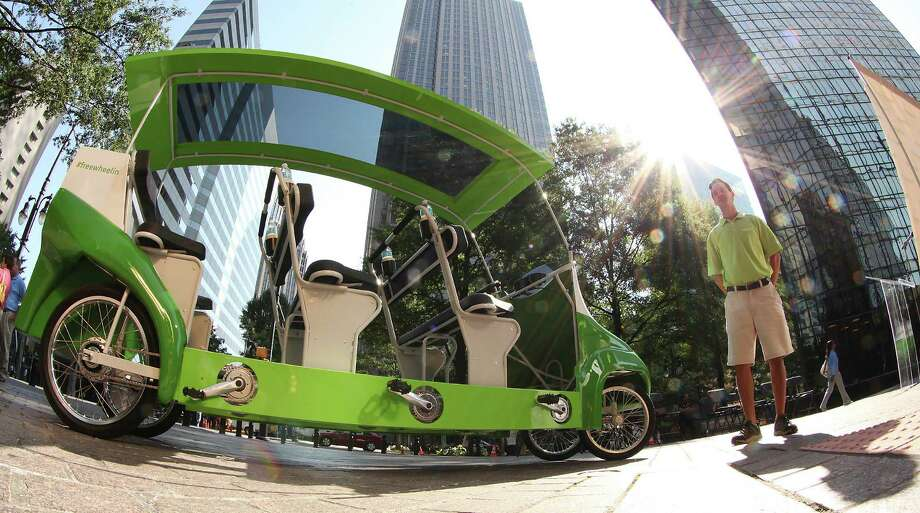 COMMERCIAL IMAGE - Twenty Humana Freewheelin pedal buses like the one shown are coming to Charlotte, NC as free, healthy transportation for anyone's use during the Democratic National Convention. Humana unveiled the pedal buses during the Charlotte Freewheelin Announcement Event on Thursday, Aug. 16, 2012 in Charlotte, N.C. (Photo by Jason Miczek/Invision for Humana/AP Images) Photo: Jason Miczek, Associated Press / Invision