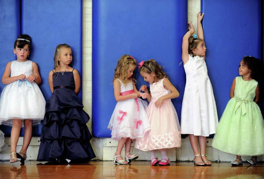 Contestants in the age four through six group wait as the judges tabulate scores during the annual Uncle Sam Pagaent in Troy, N.Y., Saturday Aug. 18, 2012. (Michael P. Farrell/Times Union) Photo: Michael P. Farrell