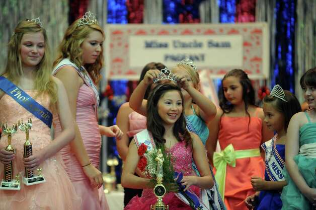Whitney Wilson, center, is crowned Pre-teen Miss Uncle Sam during the annual Uncle Sam Pagaent in Troy, N.Y., Saturday Aug. 18, 2012. (Michael P. Farrell/Times Union) Photo: Michael P. Farrell