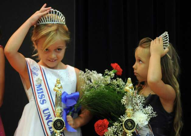 Marilyn Sullivan, winner in the Young Miss Uncle Sam category, left, and Mikayla Isby, winner in the Little Miss Uncle Sam category, adjust their crowns during the annual Uncle Sam Pagaent in Troy, N.Y., Saturday Aug. 18, 2012. (Michael P. Farrell/Times Union) Photo: Michael P. Farrell