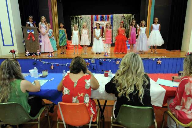 Contestants in the pre-teen group stand before the judges during the annual Uncle Sam Pagaent in Troy, N.Y., Saturday Aug. 18, 2012. (Michael P. Farrell/Times Union) Photo: Michael P. Farrell