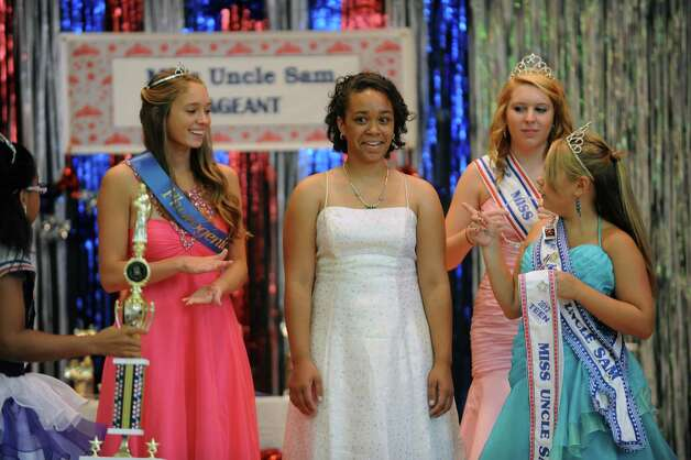 Terah Jones, center, is named Teen Miss Uncle Sam during the annual Uncle Sam Pagaent in Troy, N.Y., Saturday Aug. 18, 2012. (Michael P. Farrell/Times Union) Photo: Michael P. Farrell