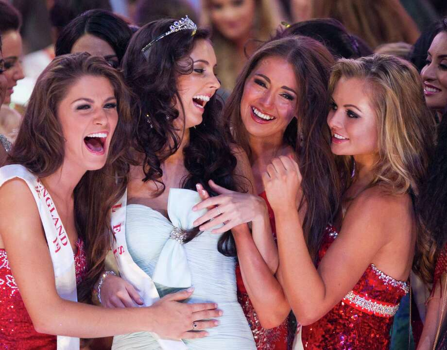 Miss World  runner-up winner Miss Wales Sophie Moulds, second left, is congratulated by other contestants. Photo: AP